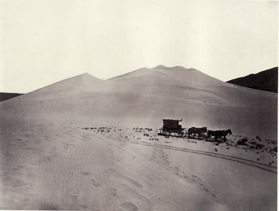 Timothy O'Sullivan's darkroom wagon, pulled by four mules, entered the frame at the right side of the photograph, reached the center of the image, and abruptly U-turned, heading back out of the frame. Footprints leading from the wagon toward the camera reveal the photographer's path. Made at the Carson Sink in Nevada